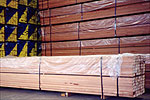 Timber being wrapped up in plastic sheets before being exported
